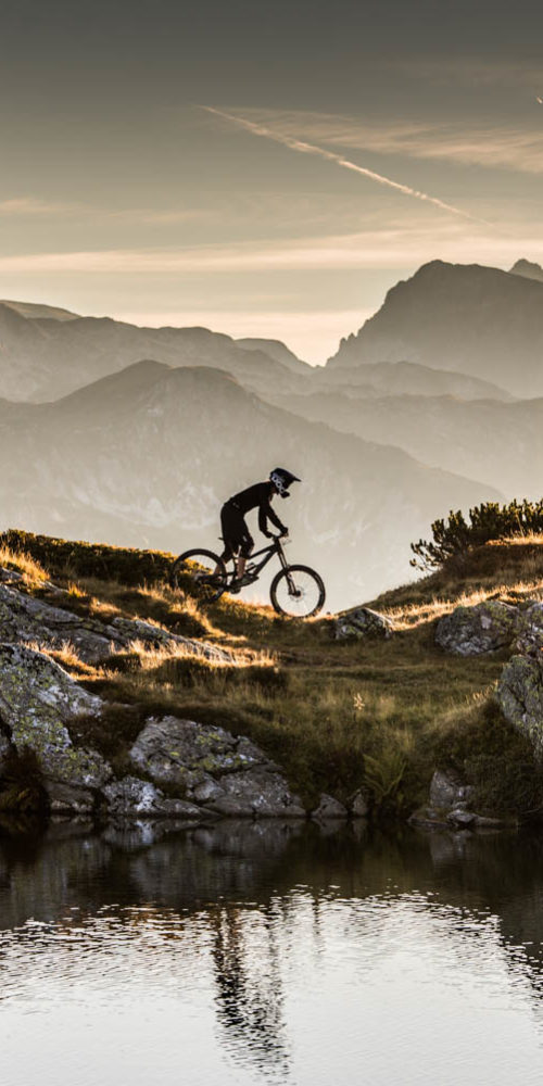 Wandbild Sonnenuntergang Mountainbike